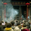 Burning incense upon the incense altar in temple — Stock Photo