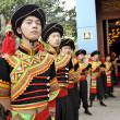 Chinese Yi ethnic dancers - Stock Photo