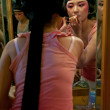 Chinese operactress painting face at backstage — Stock Photo #14951183