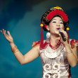 Stock Photo: Chinese ethnic singer of Yi nationality