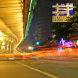 High speed traffic and blurred light trails under the overpass — Stock Photo #14955859
