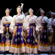 Pretty Tibetan dancing girls — Stock Photo