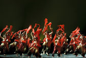 Blurred jumping of chinese national dancers — Stock Photo