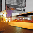 High speed and blurred bus light trails in downtown nightscape - ストック写真