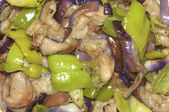 Closeup of delicious eggplant with green peppers dish — Stock Photo
