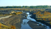 Winding river on field — Stock Photo