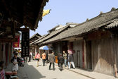 People walking on a street in chinese traditional town — Stock Photo