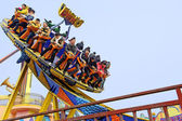 Happy playing UFO rides in an amusement park — Stok fotoğraf