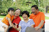 Happy kid playing with his uncle and aunt — Stock Photo