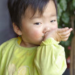 A cute baby is eating in restaurant — Stock Photo #21545879