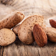 Almond nuts on wooden table — Stock Photo