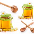 Honey in glass jar and wooden honey dipper — Stock Photo #18771137