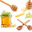 Stock Photo: Honey in glass jar and wooden honey dipper