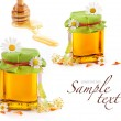 Honey in glass jar and wooden honey dipper — Stock Photo