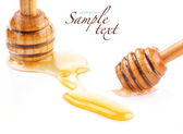 Wooden honey dipper and Honey drops — Stock Photo