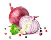 Onion with peppercorn and parsley — Stock Photo