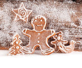 Festive gingerbread on wooden background — Stock Photo