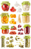 Collections of preserved vegetables in glass jar — Stock Photo