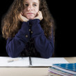 Teen doing her homework — Stockfoto