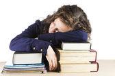 Teen sleeping on her books — Stock Photo