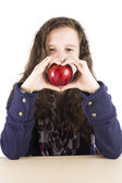 Teen holding a red apple — Stock Photo