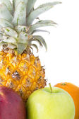 Pinapples, apples and oranges — Stock Photo