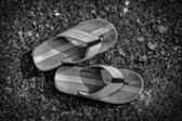 Slippers with old background — Stock Photo
