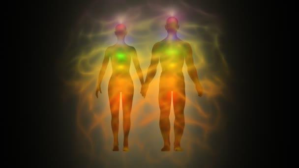Woman and man energy body, aura, chakras — Vidéo
