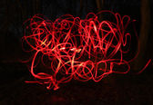 Blur photo of red bike lamps — Stock Photo
