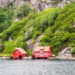 Foto Stock: Red fjord houses