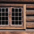 Weathered log house wall window — Stock Photo #12491377
