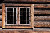 Weathered log house wall window — Stock Photo