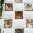The mosaic tiles wall in the park Guell - Stock fotografie