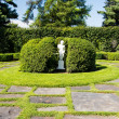 White statue in garden — Stock Photo