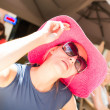 Portrait of young womin red hat with sunglasses — Stockfoto #12642360