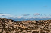 Four wind mills in mountains — Stock Photo