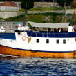 Boat with Akershus Fortress Oslo Norway - Stock Photo