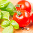 Basil leafs cherry tomato pepper corn - Stock Photo