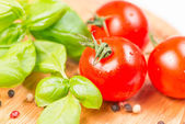 Basil leafs cherry tomato pepper corn — Stock Photo