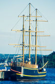 Sailing ship with tall masts moored — Stock Photo