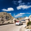 Small european car on winding road of Mallorca Spain - Stock Photo