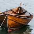 Wooden boat on water — Stock Photo #13414061