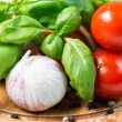 Stock Photo: Basil tomato garlic and corn pepper on wooden cutting board