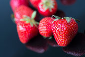 Strawbwrries on black — Stock Photo