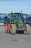 Green Tractor on parking — Stock Photo