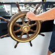 Stock Photo: Capitan hand steering a boat