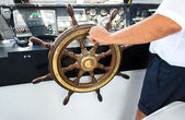 Capitan hand steering a boat — Stock Photo