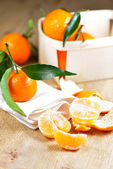 Pealed satsuma on wooden table — Stock Photo