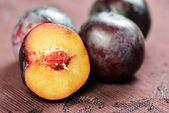 Plums on table close up — Stock Photo