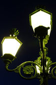 Decorative lit lamp post — Stock Photo